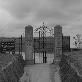 The entry gate into the course. Note the blackboard on the left, which advises the time, date and height that the tide will be on the entry road. Yes, on the entry road!