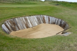 One of two green side bunkers on the 1st hole. It is the first of many bunkers you will encounter constructed using timber sleepers.