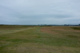 The view of the narrow 5th fairway from just beyond the ridge over which you must drive.