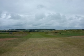 The view from the 12th fairway. The green on this hole is located on top of a low ridge and guarded by a lone bunker to the front right. Interestingly the putting surface is set down slightly making it blind from the fairway.