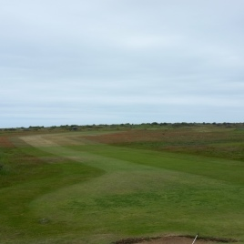 The view from the right-hand side of the green on the 12th hole looking back down the length of the fairway.