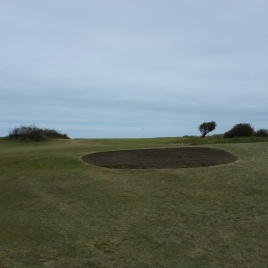 The view from the 13th fairway, from just in front of the first bunker. This image gives a good indication of the sharp rise in elevation over the last third of this hole.