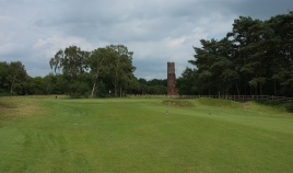 The view of the 3rd green from the fairway, with the Tower on the Moor in the background.