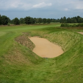 Looking back from the left-hand side of the 4th green at one of three bunkers that protect the green.