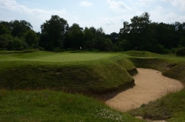 The view of the 5th green from front right. Note the huge bunker wrapping across the front and down the right-hand side of the putting surface. It is one of five bunkers that guard this green.