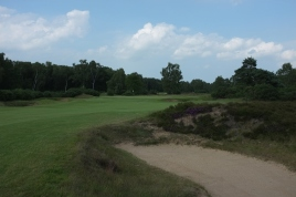 The view from the right-hand side of the 6th fairway, showing the green protected by three bunkers to the left and one to the right.