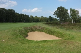 The view from the right-hand side of the 7th fairway showing the last of a trio of bunkers which guard the inside of the dog-leg on this hole.