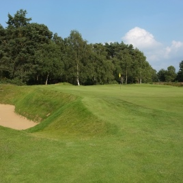 The view of the 12th green from front left. Note the huge bunker on the left-hand side of the green, which is one of six bunkers that surround this green.