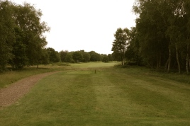 The view from the 18th tee - taken from the yellow tee markers. From here the hole is 98 yards shorter than the back markers. As a result it reduces from a par five to four, playing at a stern 442 yards.