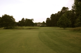 The view from the 18th fairway. Note the cross bunker on the left-hand side, which separates the fairway. This bunker actually comes into play from the tee when hitting off yellow markers.