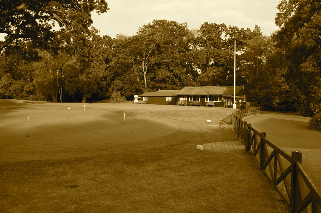 The view across the practice putting green to the 1st tee, with the starters hut in the background.