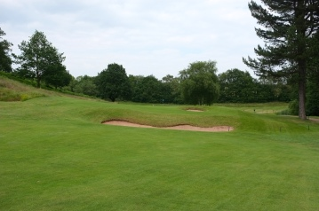 The view of the approach to the 10th green, showing the cross bunker guarding the right-half of the fairway.