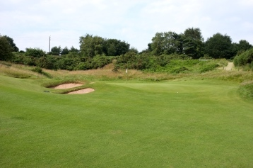 The view of the 11th green from the fairway.