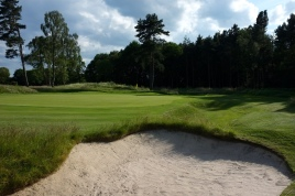 The view of the 9th green from front right, over one of two large bunkers that flank the approach.