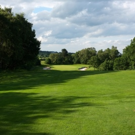The view from a little further up on the 10th fairway - showing more of the green and its surrounds.