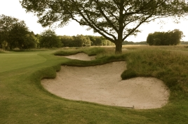 A pair of greenside bunkers guard both sides of the the putting surface at the par four 13th hole. Pictured here are the pair located on the right-hand side. They are just two of fourteen bunkers which can be found on this hole.