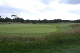 The view from behind the 3rd green showing the tier in putting surface, which is blind from the fairway.