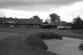 The view from in front of the 18th green looking north-west towards the clubhouse and pro shop, with the 1st tee set directly in front of those two buildings.