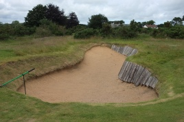 Some of the faces to the bunkers are so steep that they have been shored up with timber railroad ties to stop them from collapsing.