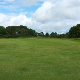 The view from in front of the green looking back down the length of the hole. Note the player friendly V-shaped contouring of the ground, which helps to gather balls to the centre of the fairway.