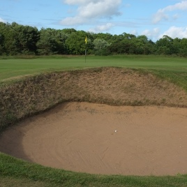 The view of the 7th green from the right-hand side, showing one of three bunkers that guard the putting surface.