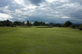 The view from the 11th fairway. Note the two large cross bunkers short of the green.