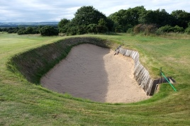 A view of one of the two deep cross bunkers that sit in the fairway some 70-80 yards short of the green.