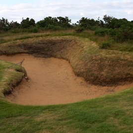 A view of the punishing fairway bunker on the left-hand side of the 14th hole, which helps protect the green from being driven at this short par four.