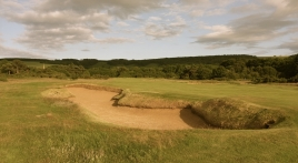 The view of the huge fairway bunker that sits in the left-hand rough on the 15th hole.
