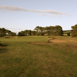 The view from the start of the 17th fairway, showing four of the six bunkers that line both sides of the hole.